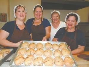 """The pasties are flaky, baked, hand-crimped dough with fillings such as potatoes, vegetables, onions and parsley. Others include chicken or turkey, broccoli, beef or ham. Dessert pasties, known as """"apple figgies,"""" are spiced with cinnamon and raisins. From left, Carol Sanger, Jessie Rollins,Susan Crowder and Carrie Marshall Locks. http://www.youtube.com/watch?v=uQf7WJpTRBw"""
