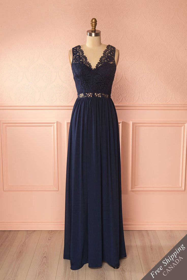 Brinda Navy #boutique1861 / This elegant gown is perfect for bridesmaids. The crocheted top is lined around the bust and upper back. The flowing skirt will allow you to dance elegantly all night long!