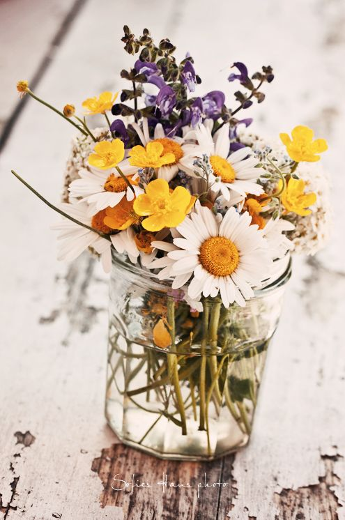 A little bunch of wildflowers in a jam jar adds a simple touch of colour and English country charm to any table or sideboard.
