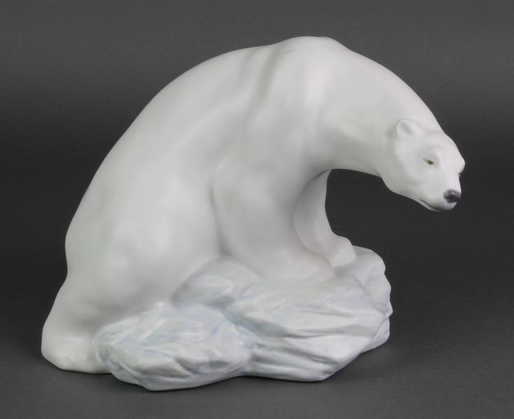 """Lot 73, A Lladro figure of a Polar Bear sitting on a rock 8481 10"""", sold for £110"""