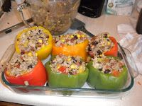 Committed to Get Fit: Eat Clean Stuffed Peppers...On the bland side but once I added spaghetti sauce and some good ol cheese it was really good. Ryan even liked this so WIN - Gina