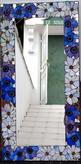 Rectangular mirror with glass flower mosaic border. Private commission.