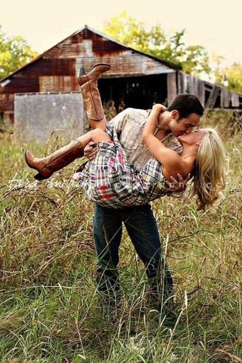Outside, rustic theme, cowgirl boots. Engagement photos