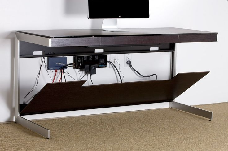 A desk that features magnetically attached front and back panels to conceal unsightly cords and cables. When it comes to wire management, we've got you covered. (Click the link to discover even more options!)