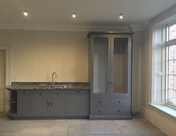 Beautiful hand painted kitchen in farrow and ball moles breath. Courtesy of Kevin Mapstone