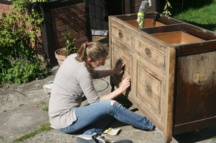 DIWife sands down the cupboard to remove the old varnish and provide a key for the paint