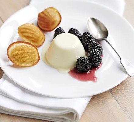 Lemon panna cotta with blackberries & honey madeleines: Creamy panna cotta, plump British blackberries and warm honey madeleines make a special dessert with very little effort.