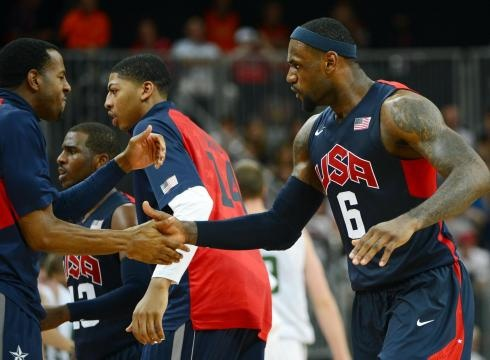LeBron James high-fives Andre Iguodala during Team USA's 99-94 victory against Lithuania on Saturday.