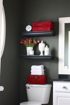 Adding red pops to the gray bathroom in a way that the accent color is easily changed by the next home owner.