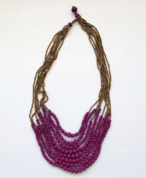 Plum-colored paper beads hang in a stranded shower to bring some brightness to your look. #handmade #plum #paperbeads