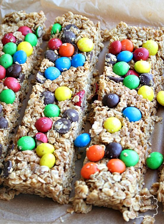 No bake granola bars  2 cups of rolled oats  1 cup of crisped rice cereal  2/3 cup of honey {of agave, or maple syrup...just something STICKY}      2/3 cup of peanut butter      2 tsp vanilla      1/2 cup of m&'s - I used a mix of m and chocolate chips}