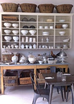 dishes on display. white and wood. industrial dining set. wicker baskets