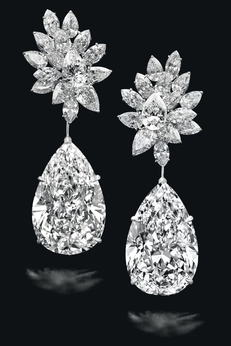 'MIROIR DE L'AMOUR'. A SENSATIONAL PAIR OF DIAMOND EARRINGS, BY BOEHMER ET BASSENGE. Each pear-shaped diamond pendant, weighing 52.55 and 50.47 carats, to the pear-shaped and marquise-cut diamond cluster surmount, 7.0 cm, mounted in gold. Signed. Price Realised USD 17,766,004 // Estimate USD 20,225,988 - USD 30,338,982. GIA / 52.55 & 50.47 carat dia. are D, Flawless / Type IIa. 30 dia. are D, Flawless or Internally Flawless clarity [C. Geneva Magnificent Jewels - 15 November 2016 - Geneva]