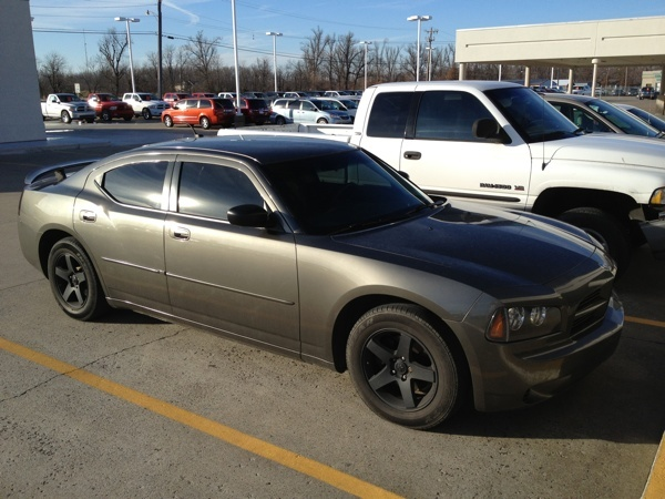 2008 Dodge Charger SE (2.7L engine)   PRICE: $12,990.00   MILES: 70,531  1 Owner Local Trade / No Accidents  FREE VEHICLE HISTORY REPORT  (Blacked Out, Tint, Wheels) SHARP!   2.7L Engine, Good MPG, Spoiler, Power Windows / Locks , Tilt & Telescopic, Custom Tint, Custom Wheels, Super Clean Interior & More
