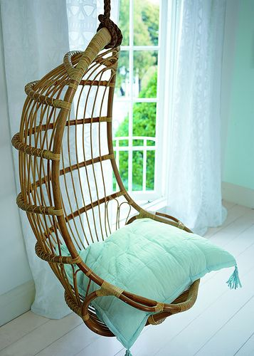 Hanging Rattan Chair in a cool mint shade, perfect for a relaxing summer afternoon!