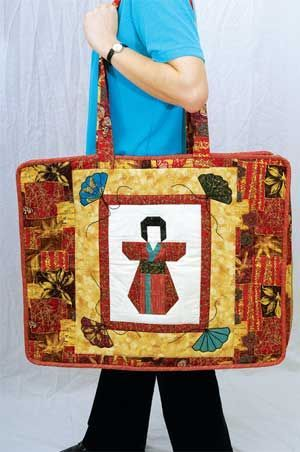 Get organized with this quilter's carry bag, with space for all your mats and rulers and part sewn projects too. Designed and made by Paula Dighton