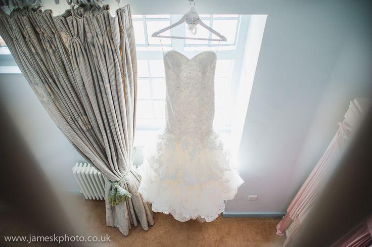 Wedding at Woburn Abbey, Bedfordshire. Bride and bridesmaids getting ready. Wedding dress. www.jameskphoto.co.uk