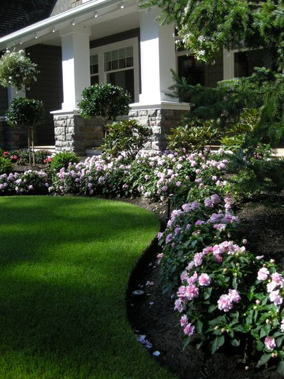 Front Yard Boarder Garden. http://pinterest.com/intlhomeshow/ plants/flowers surrounding grass