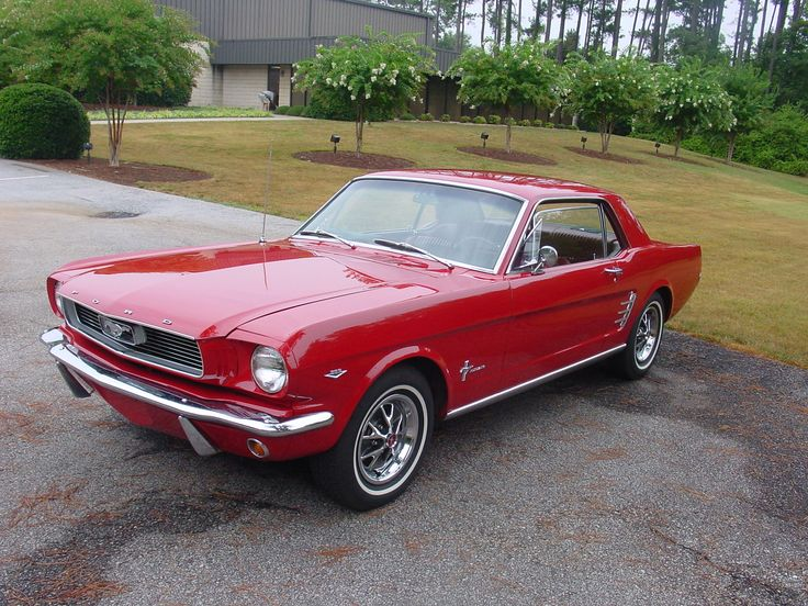 When I'm rich or dying, this is the car I'll buy.  Red 1966 Mustang.