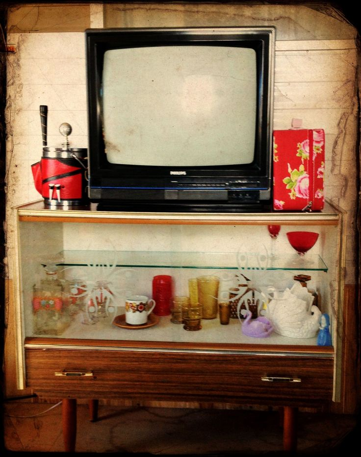 Retro glass buffet cabinet used as a TV stand.