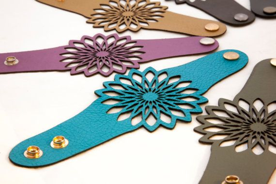 This beautiful leather bracelet features a geometric flower design that is ornate, stylish and very cute. With several vibrant colors to choose from, this leather bracelet accessory is thin, light, soft and comfortable to wear. This wrap leather bracelet has a 1-1/4 inches wide leather band and the flower at 3-1/4 wide. Please leave a note with your purchase if you need custom sizing. About my leather: The leather I use for all my designs is very light and thin (0.04 in) and ther...