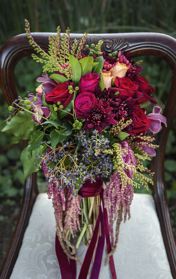 Berry toned wedding bouquet with orchids, roses and amaranthus | Taylor Mitchell Photography | See more: http://theweddingplaybook.com/lush-autumn-wedding-inspiration/