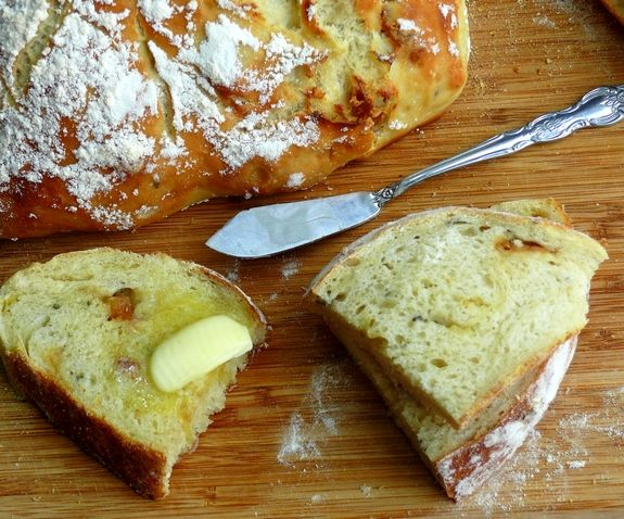 Easy Artisan Roasted Garlic Rosemary Bread with butter