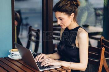 terasse: Attractive business woman working at his laptop in a cafe on the terasse Stock Photo