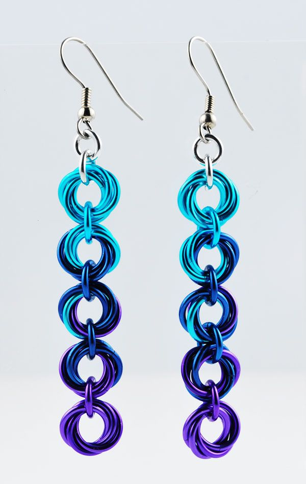 """A long pair of earrings (approx. 2"""" not including earwire) that can be customized in a variety of colors; my favorites are definitely the 2- and 3-color fades. For shorter versions, see the [Single-Flower](http://rebecamojica.com/product/single-flower-earrings?tid=3) and [3-Flower earrings](http://rebecamojica.com/product/single-flower-earrings?tid=3). Anodized Aluminum with surgical steel earwire."""