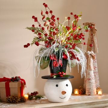 Bring holiday cheer to your home with our Pre-Lit Jolly Snowman Floral Arrangement! #Kirklands #HollyJolly #holidaydecor #KirklandsHoliday