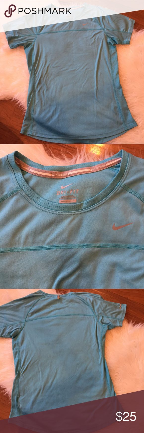 """Nike Dri-Fit Shirt A women's Nike blue reflective silver short sleeve. Fabric provides cooling air flow and breath ability. Condition: gently worn but in near perfect condition. Approx measurements: chest: 35.5""""-38"""" NO TRADES OR MODELING b:1 Nike Tops Tees - Short Sleeve"""