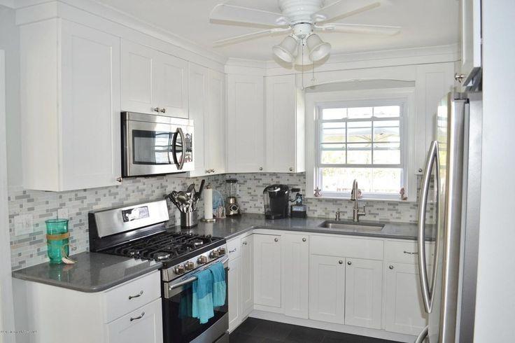 Transitional Kitchen with High ceiling, Flat panel cabinets, U-shaped, flush light, slate tile floors, Flush, Undermount sink