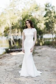 Roxanne- High neck, soft lace gown with a low back