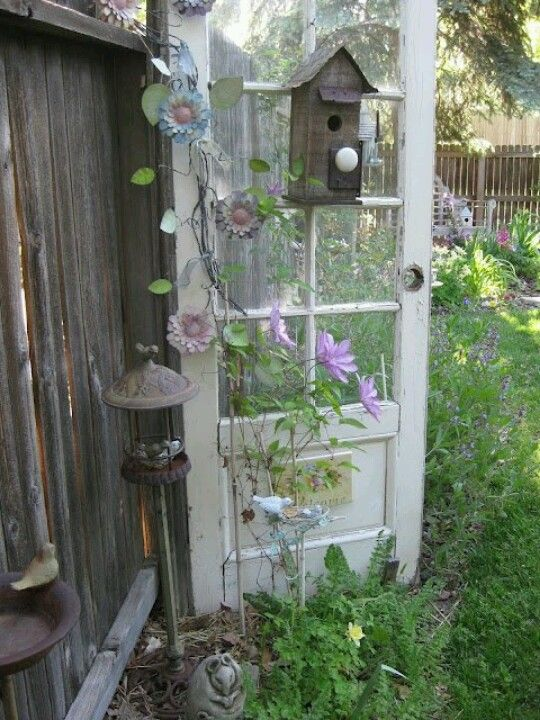 Love this old door outside with the birdhouse on it!