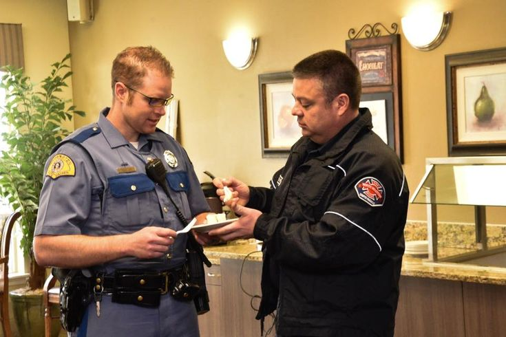 Our Spring Creek community residents had a delightful time being served a slice of #retirementperfected by local first responders. #livingperfected #diningperfected #seniorliving #memorycare #assistedliving