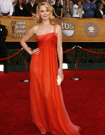 Katherine HeiglIn a draped dress by Kevan Hall in the perfect orange-red shade.  Read more: Katherine Heigl Images - Red Carpet Photos of Katherine Heigl - Harper's BAZAAR  Follow us: @Kerry Pieri on Twitter | HarpersBazaar on Facebook  Visit us at HarpersBAZAAR.com