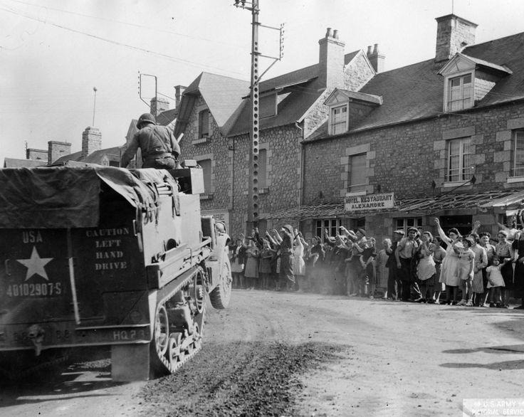 Inhabitants of the liberated town Avranches,  welcomed bids M3A1 Staff of the…
