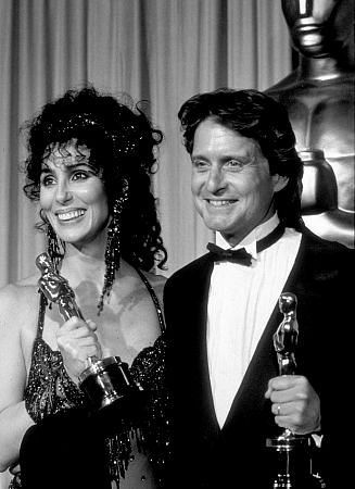 """""""Academy Awards: 60th Annual,"""" Cher (Best Actress) and Micahel Douglas (Best Actor). 1988."""