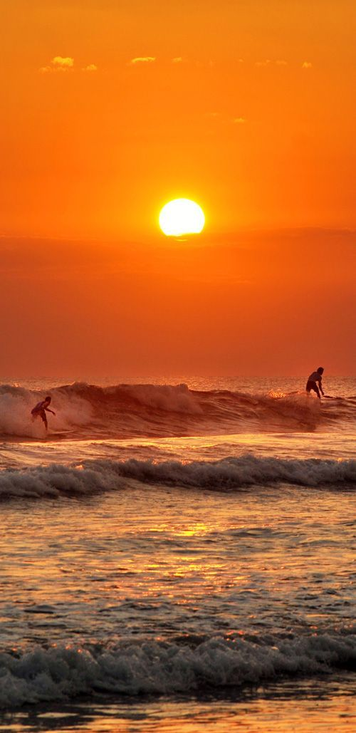 Sunset surfers at Jaco Beach, Costa Rica