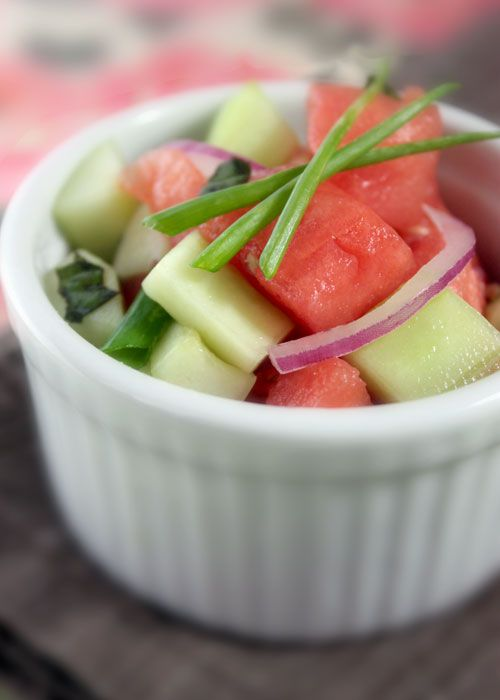 """Cucumber Watermelon Salad    Ingredients:    2 tablespoons RICE WINE VINEGAR  1 tablespoon runny HONEY (optional, sub out for vegan)  3 CUCUMBERS, peeled, deseeded and cut into 1/2"""" cubes  3 cups 1/2"""" cubed WATERMELON  1/4 cup sliced fresh BASIL LEAVES (stack leaves, roll lengthwise and slice)  1/4 cup thinly sliced RED ONION"""