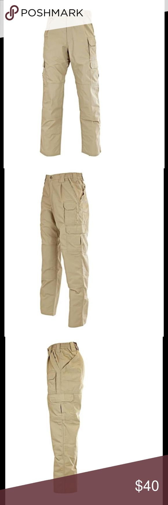 5.11 Men's Tactical 74273 TacLite Pro Pant 32x32 Features of 5.11 Taclite Pro Pants Fabric weight: 6.14oz. 65% polyester / 35% cotton ripstop fabric Teflon treatment resists stains and dries quickly Elastic waistband provides a flexible fit Reinforced with 48 bar-tacks and triple stitching Draw-cord blousing system D-ring on the hip 5.11 buddy strap YKK zippers Two front pockets with a flat-edge coin pocket on the right side Knee-pad pockets One thigh pocket Two rear pockets Two cargo…