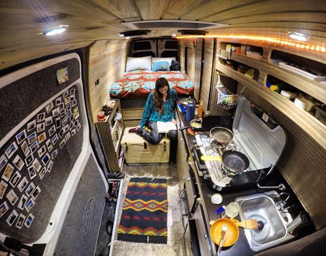 An average evening. Dani reading her book after cooking a gourmet meal waiting for the world's best dish washer (that's me) to work his magic! #vanlife