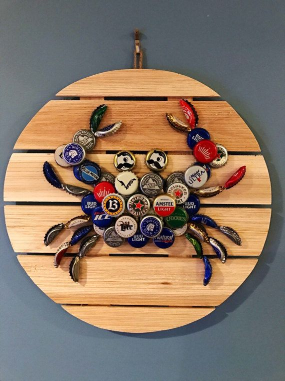 Maryland crab wall hanging made out of local beer caps and mounted on a 13 diameter wood pallet. You may customize the beer caps used for the eyes of the crab.  Customization of wooden pallet color and size is also available upon request (message seller). Size increase/customized color may increase price.