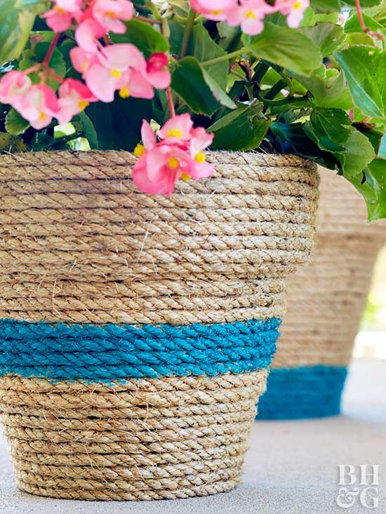 This DIY planter couldn't be any easier. Wrap a long strand of twine or rope around a pot (exact length depends on the size of the pot) and secure with hot glue. Then paint desired strands with colorful latex paint.
