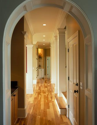 This traditional plantation style house features unusual hickory flooring with IPE inlays in the entry foyer