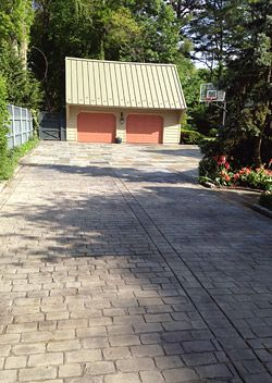 stamped concrete driveway that looks like cobblestone