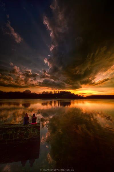 2 girls and a dark cloud by Stefan Kierek