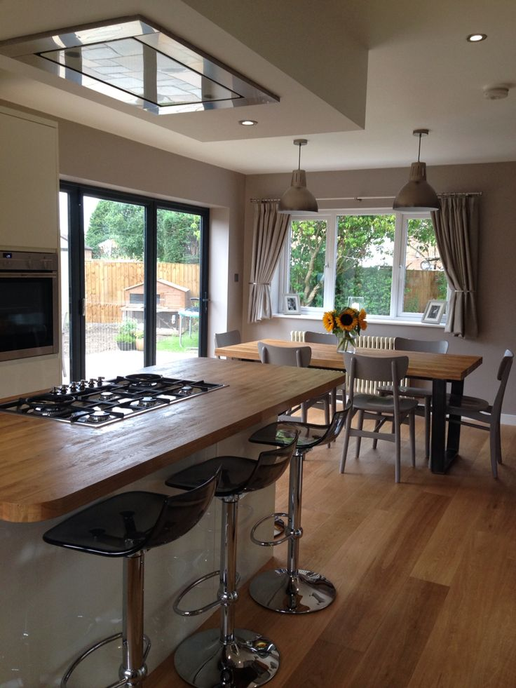 My new kitchen/dining room. John Lewis Hampton silver pendants, Asta dining chairs in mocha, Calia dining table & sideboard, LED bar stools in smoke, Luxair ceiling hood/extractor, Smeg flush gas hob, Walls in Dulux soft truffle.