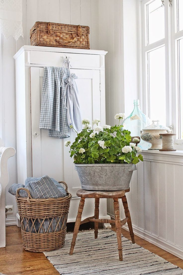 beautiful bathroom vignette! love the galvanized pot for flowers on the rustic wooden stool and real basket for laundry hamper.