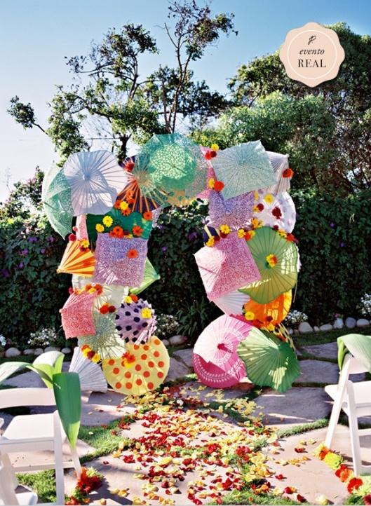 Crazy wedding alter made of funky umbrellas